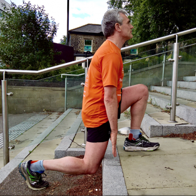 running coaching client andrew stretching